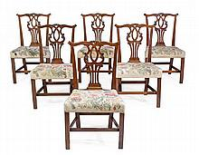 A set of six mahogany dining chairs in George III