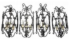 A set of four cast metal three light wall