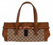 Gucci, a canvas and leather monogram hand bag, with twin loop handles