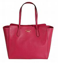 Gucci, Swing, a fucshia leather tote bag, with double leather handles and...