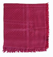 Gucci, a silk and wool scarf, the monochrome fucshia ground woven with a...
