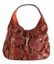 Gucci, Jackie, a soft red python hobo handbag, with chrome hardware