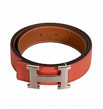 Hermes, Constance 32, a belt in coral calfskin reversible to tan textured...