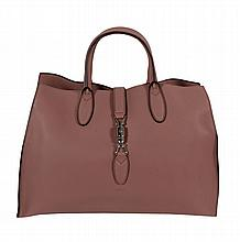 Gucci, an 'ancient pink' leather handbag, with twin rolled leather handles...
