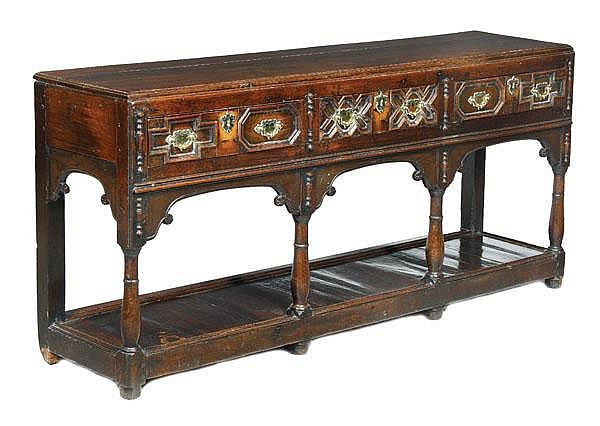 An oak dresser base, 17th century and later,