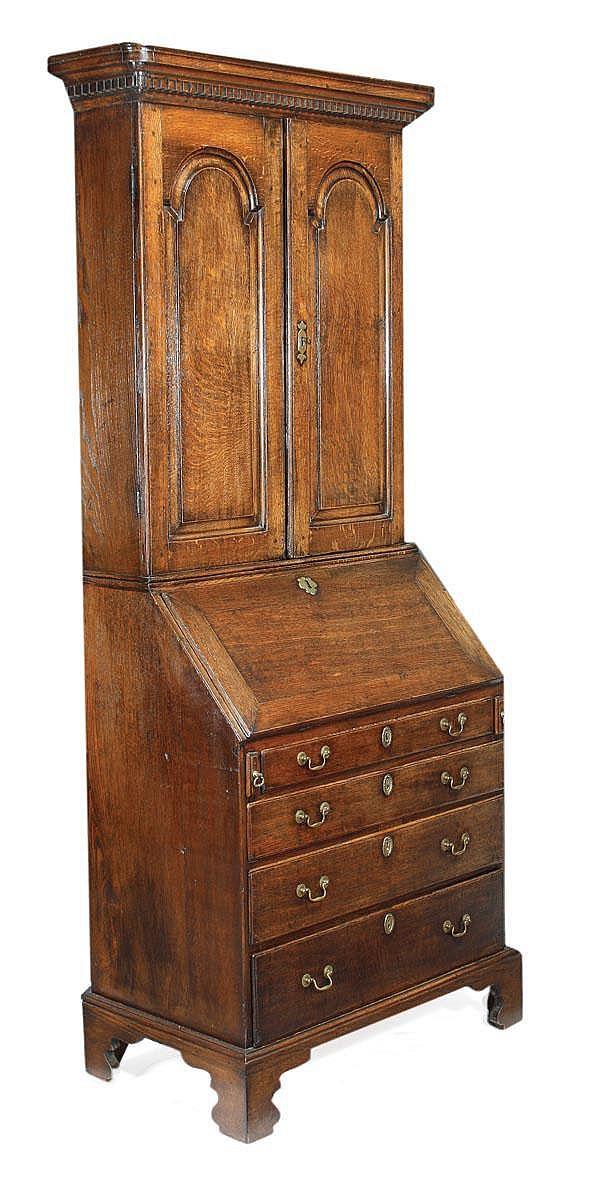 A George II oak bureau bookcase, circa 1740,
