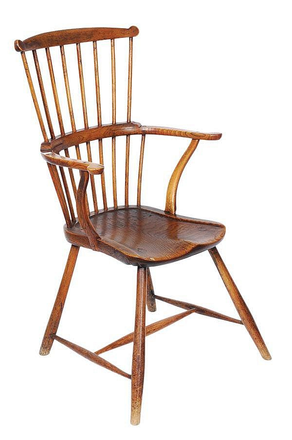 An ash and elm comb back windsor armchair, late