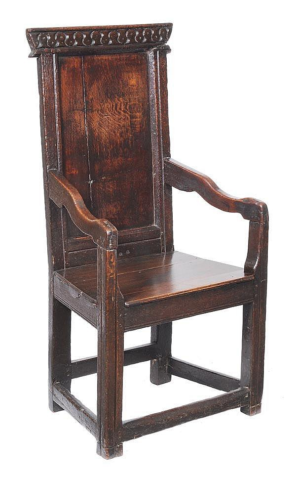 A Charles II oak caquteuse armchair, circa 1660,
