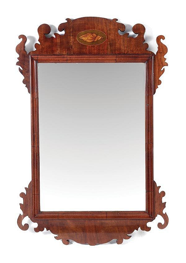 A marquetry and walnut framed wall mirror in Queen