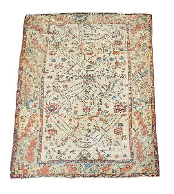 A Persian rug, approximately 210cm x 133cm