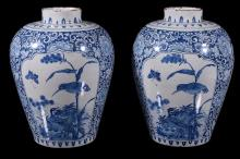 A pair of Dutch Delft blue and white chinoiserie vases, circa 1700