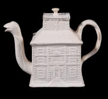 A Staffordshire salt-glazed stoneware teapot and cover modelled as a house