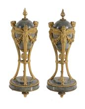 A pair of Continental mottled green marble and gilt bronze mounted urns and...
