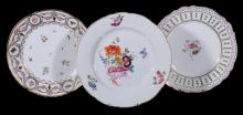 A British porcelain plate, circa 1820, painted with a central rose spray in...