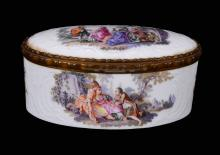 A German porcelain gilt-metal-mounted oval box and hinged cover
