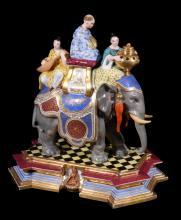 A Paris porcelain model of a caparisonned elephant and oriental riders