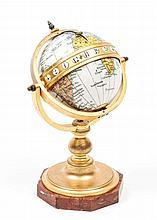A French enamel, gilt-brass and rouge marble eight day globe timepiece