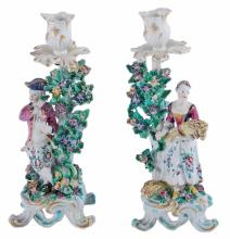 A pair of Bow porcelain figural candlesticks emblematic of Autumn and Summer...