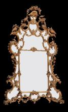A carved giltwood and composition wall mirror in George III style
