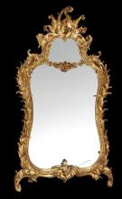 A carved giltwood wall mirror in George III style, 19th century
