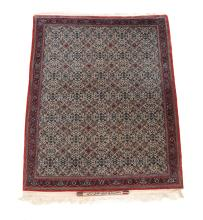 An Esfahan rug , with signature panel appears to state ' by order of Sadegh