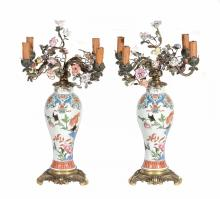 A pair of French gilt metal and porcelain mounted four light candelabra