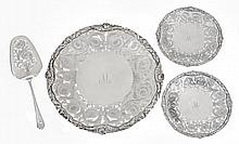 A matched silver dessert serving plate, two