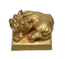 A Chinese gilt-bronze seal, well cast with a recumbent lion on square base, 5