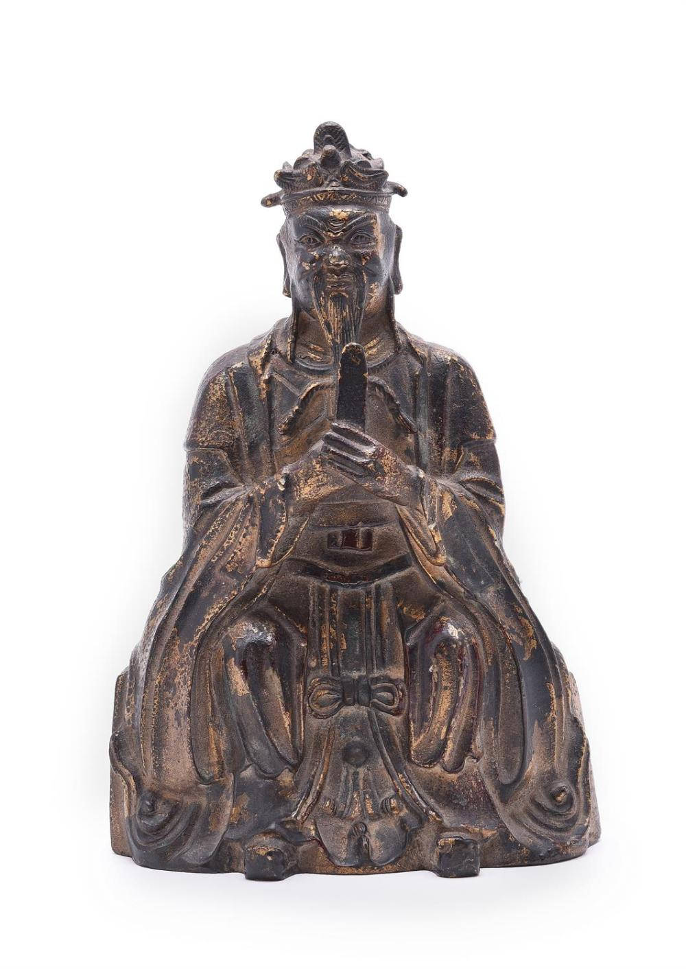 A Chinese gilt bronze and red lacquer Daoist figure of an Immortal