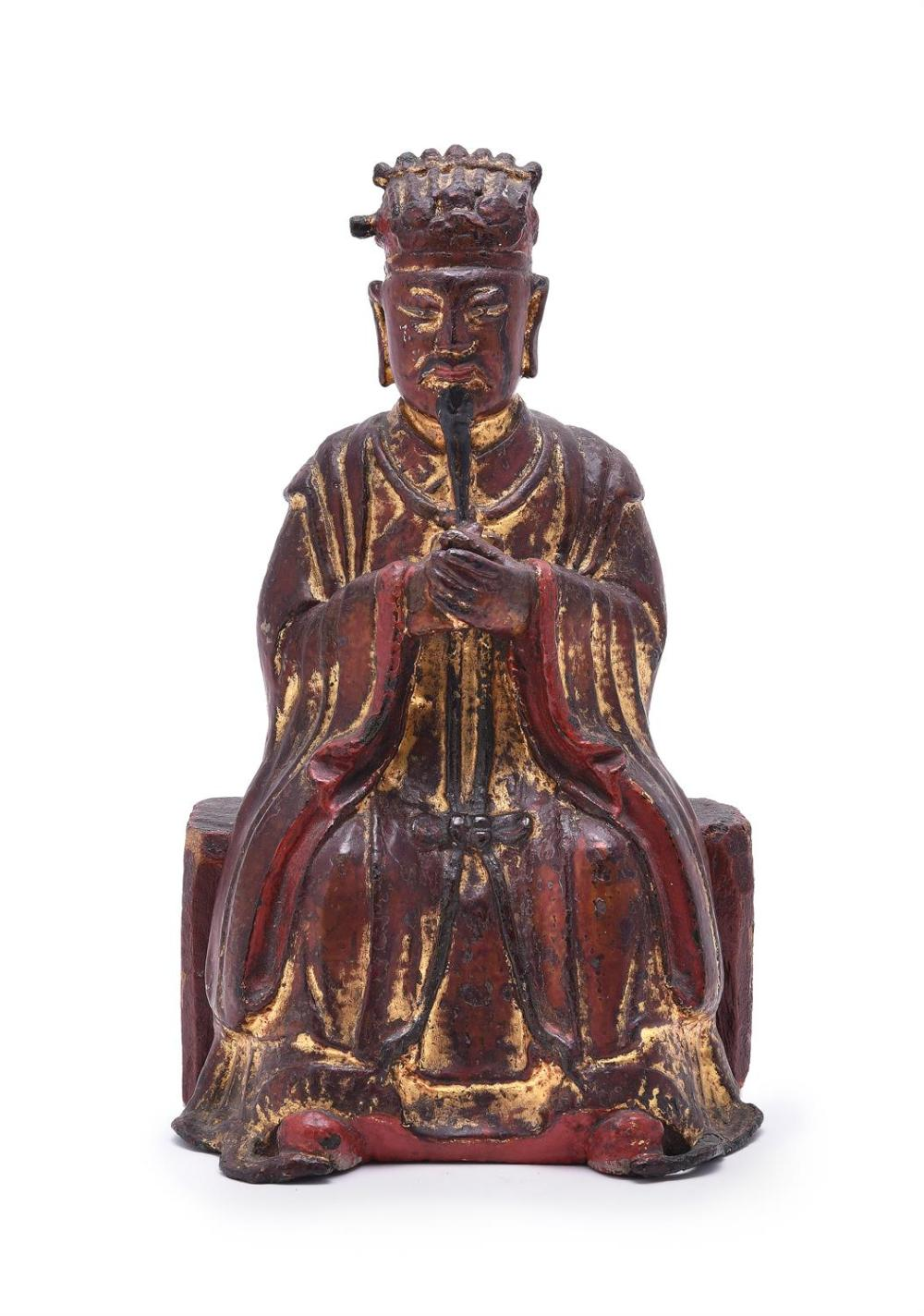 A Chinese bronze lacquered and gilt figure of a seated bearded Official