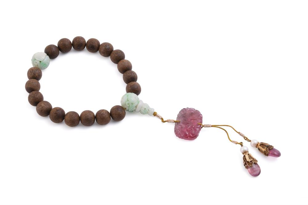 A Chinese aloeswood and jadeite rosary bracelet