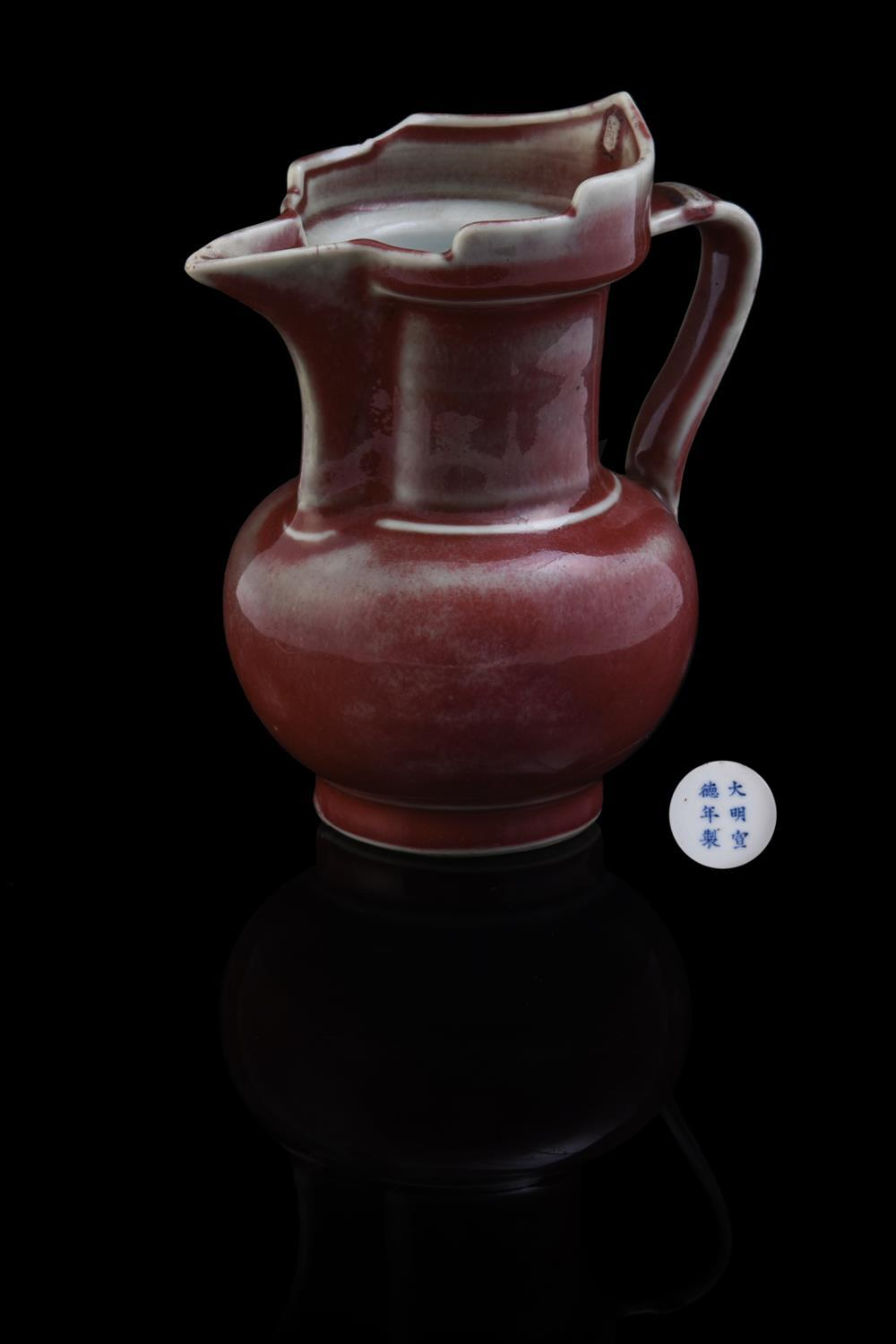 A Chinese copper-red glazed small 'Monk's Cap' Ewer
