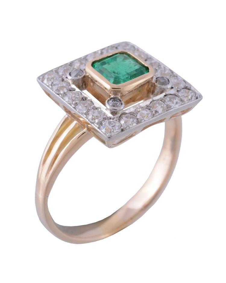 an emerald and ring the central square cut emerald