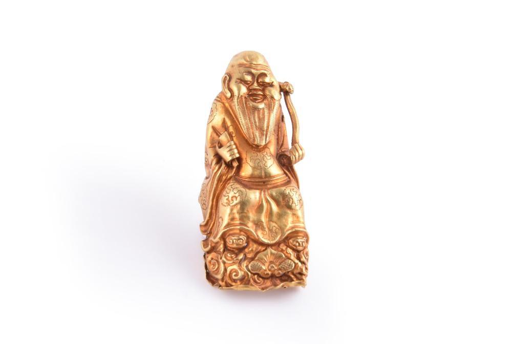 A Chinese gold 'Immortal' nail guard