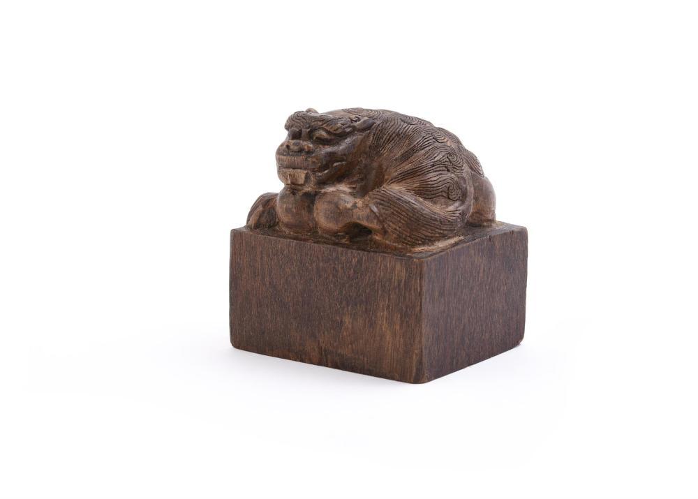 A Chinese wood 'Buddhist' lion seal