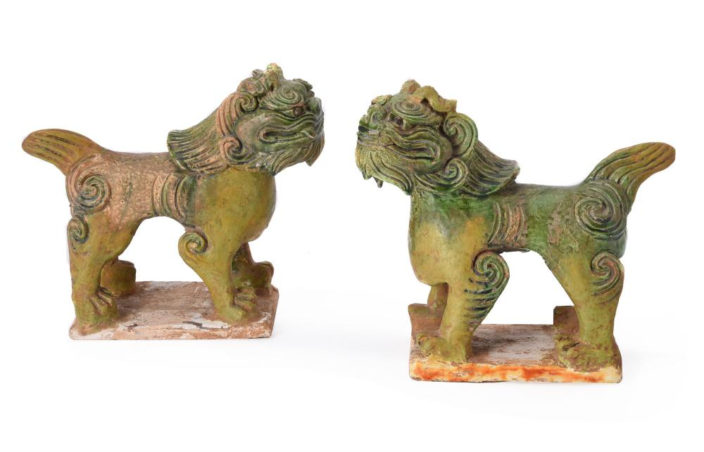 A pair of Chinese pottery green glazed Guardian Lions