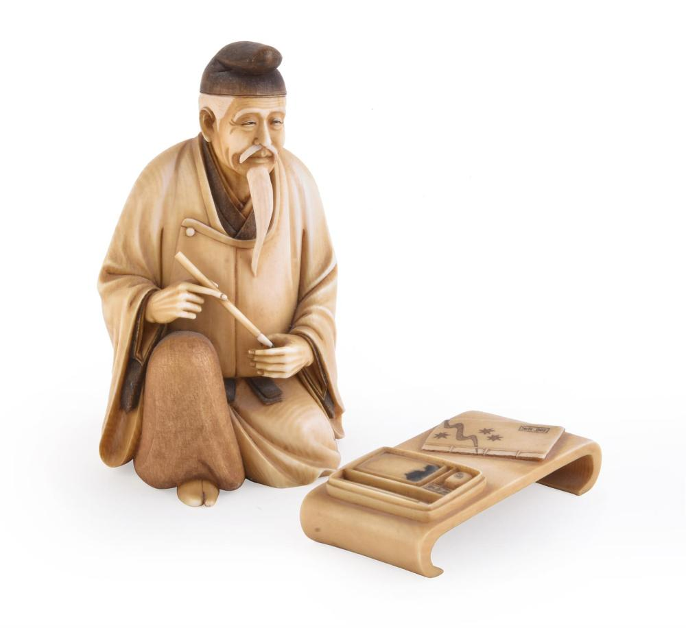 Y A Japanese Ivory Figure of a Scholar