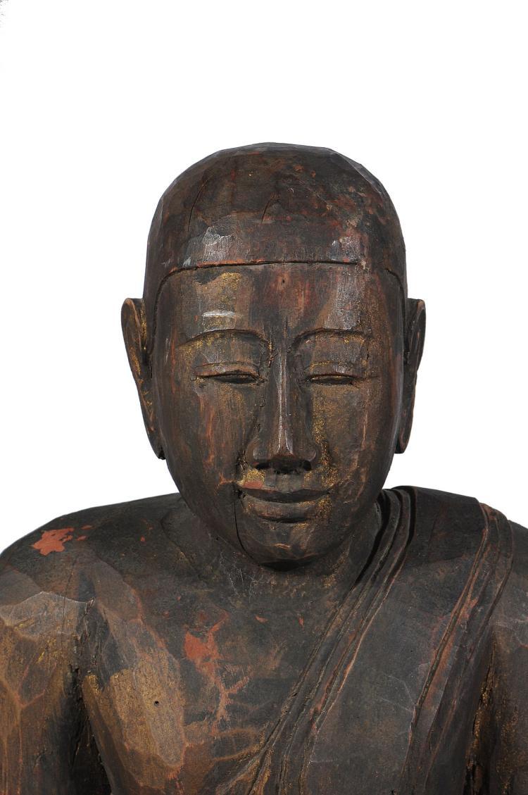A large carved wood burmese style buddha th century cm