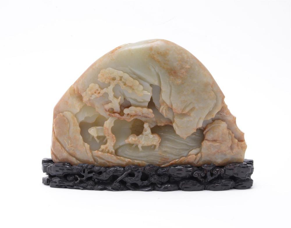 A Chinese mottled celadon jade boulder
