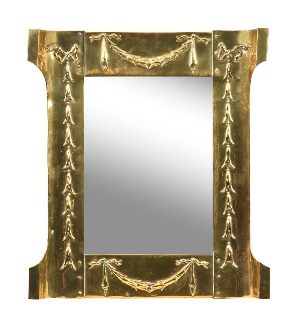 An Art Nouveau brass framed wall mirror