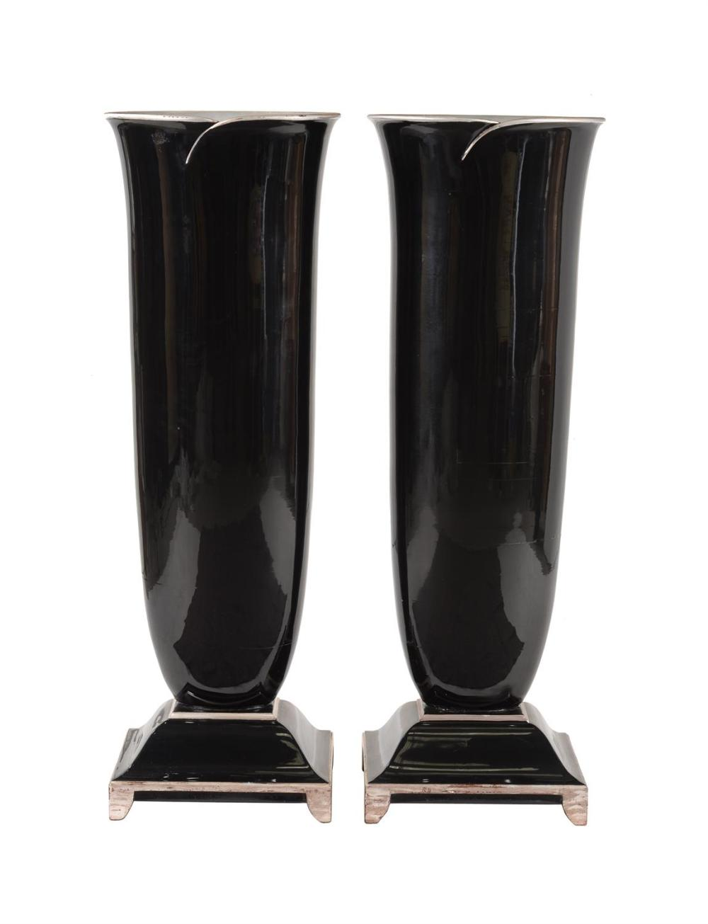 A pair of floor standing black lacquered and silver painted wooden vases