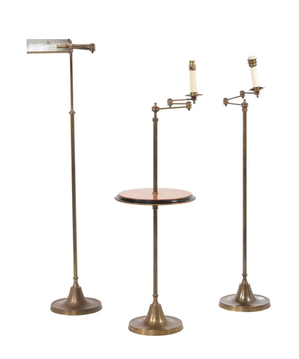An oak and brass reading standard lamp