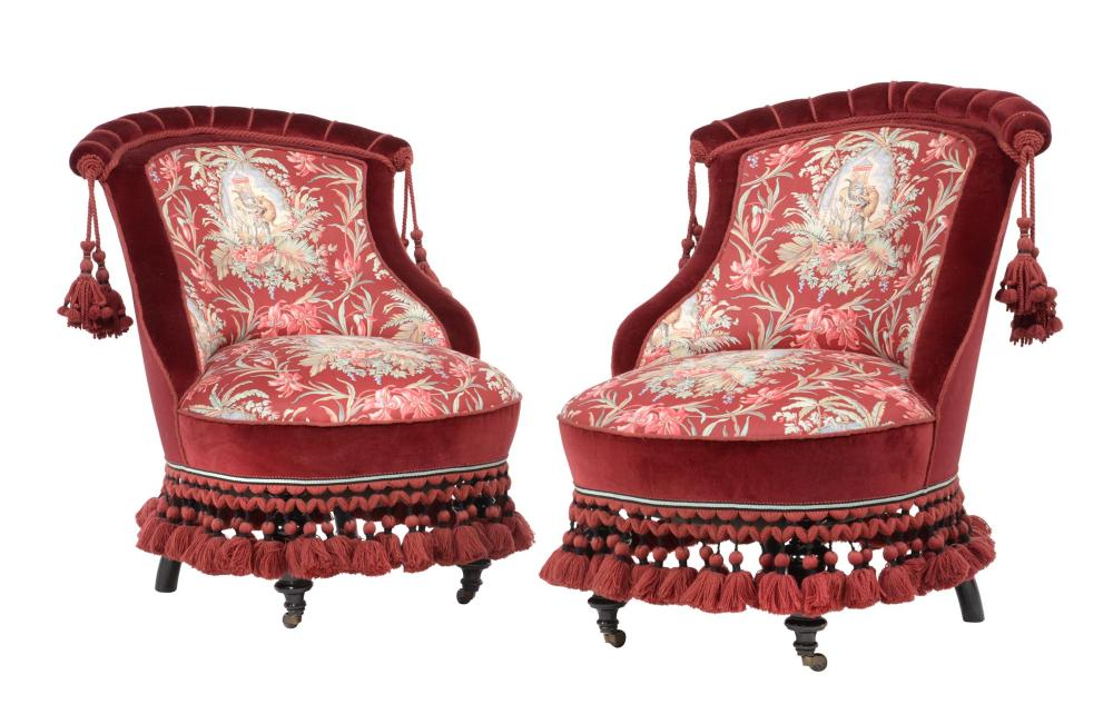 A pair of ebonised low side chairs