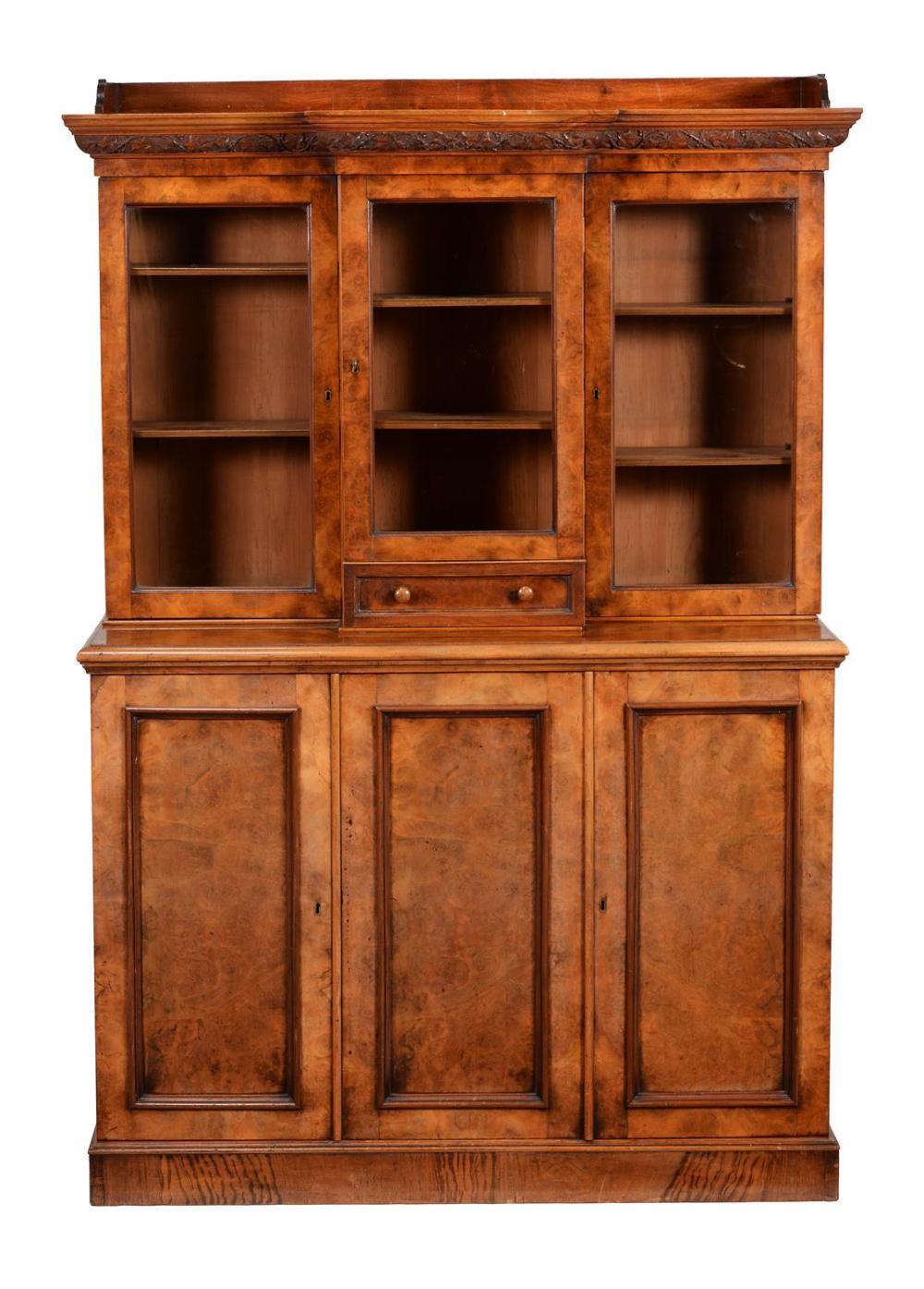 A Victorian walnut cabinet bookcase