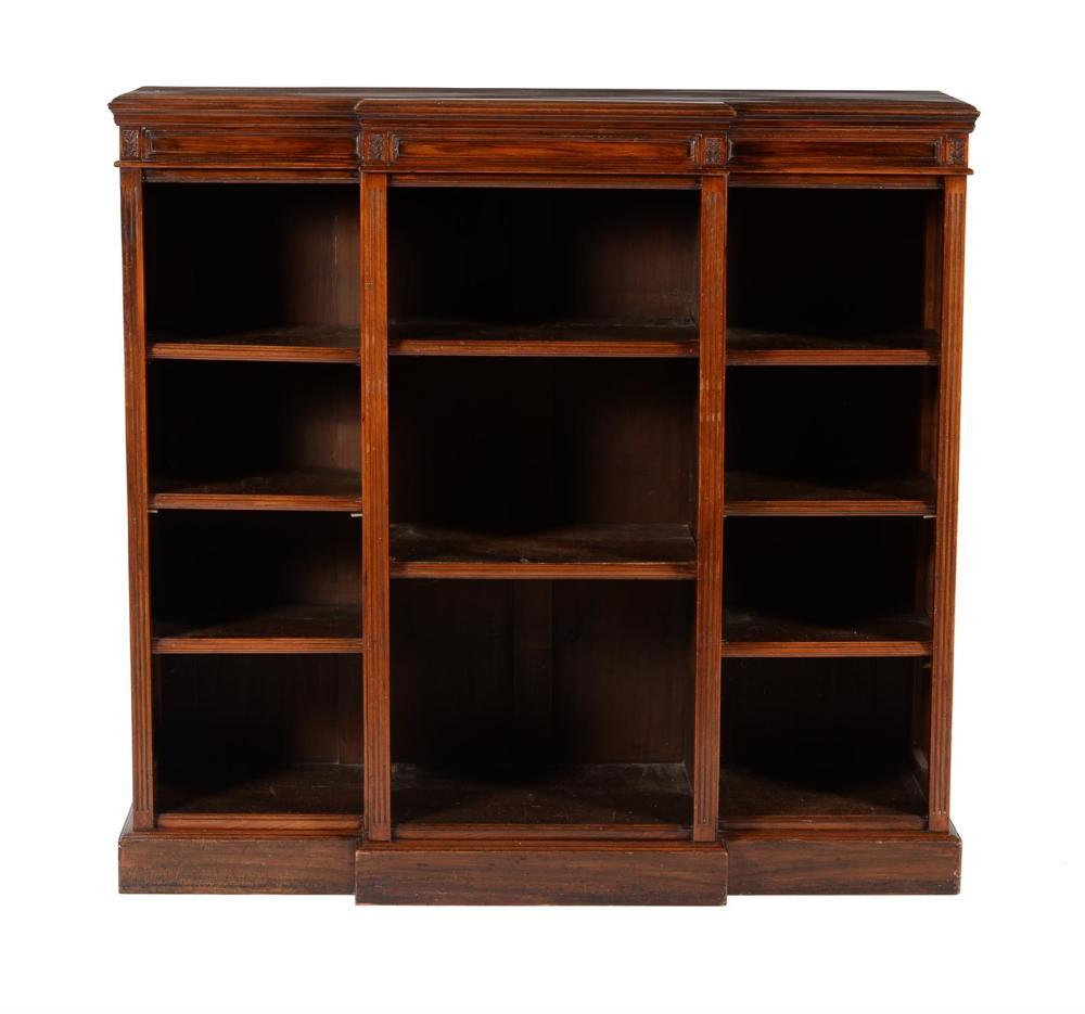 A late Victorian walnut breakfront open bookcase