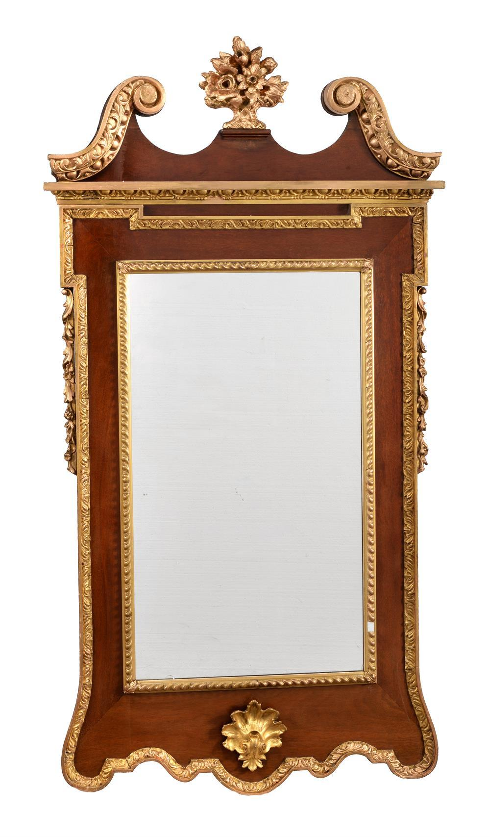 A Mahogany and giltwood wall mirror in George II style