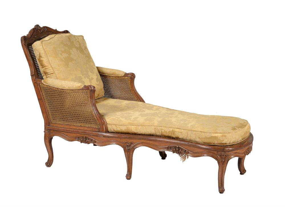 A carved walnut day bed
