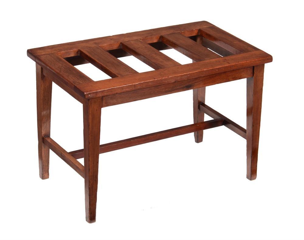 A mahogany luggage rack