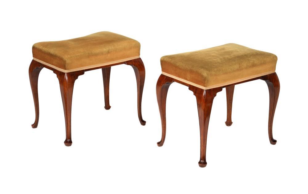 A pair of mahogany and upholstered stools