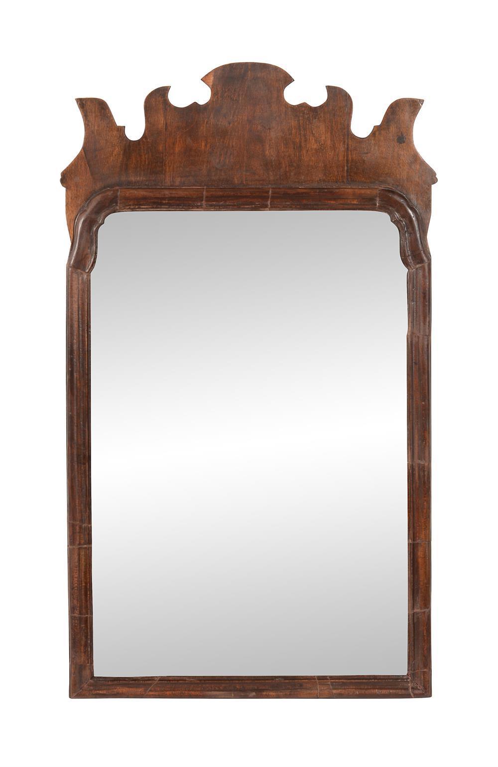 A George II walnut fret-framed wall mirror
